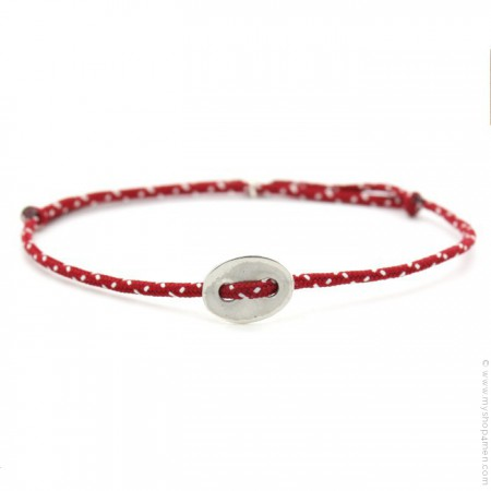 Silver button on a red and white paracord bracelet