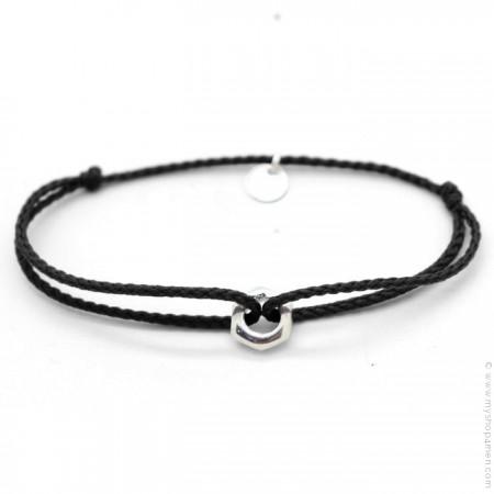 Silver nut bracelet on black cord
