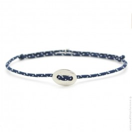Silver button on a blue and white paracord bracelet